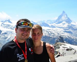 Zdenek Plachy (left) and Alexandra Pichalova at the finish of Zermatt Ultramarathon, on the top...