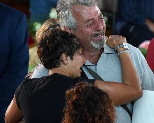 People grieve at the state funeral for victims of the Italian earthquake, in Ascoli Piceno, Photo...