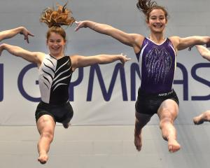 Dunedin Gymnastic Academy members (from left) Amaya Leslie (13) Abby Stevens (15), Alyssa Shelton...