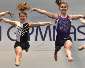 Dunedin Gymnastic Academy members (from left) Amaya Leslie (13) Abby Stevens (15), Alyssa Shelton...