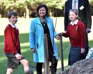 Education Minister Hekia Parata helps Kaikorai Valley College pupils Jack Hitchcox (12), Jessica...