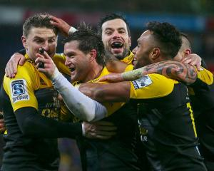 Cory Jane celebrates his try with Hurricanes' team mates. Photo: Reuters