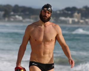 New Zealand Black Fins captain Andrew McMillan walks along the beach during a training camp on...