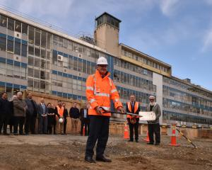 University of Otago chancellor John Ward turns the first sod at the site of the School of...