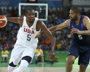 Kevin Durant drives to the hoop against France. Photo: Reuters