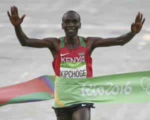 Eliud Kipchoge crosses the finish line. Photo: Reuters