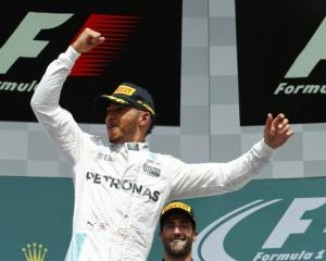 Lewis Hamilton celebrates after winning the race. Photo: Reuters