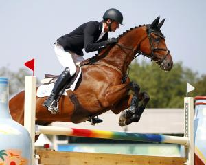 Mark Todd of New Zealand riding Leonidas II jumps during the Eventing Team Jumping Final at the...