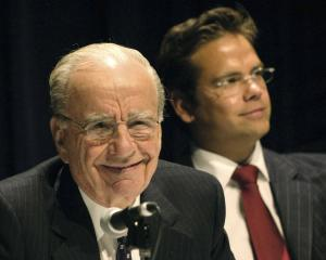 Rupert Murdoch (left), with son Lachlan next to him, after Newscorp profits doubled in 2003....