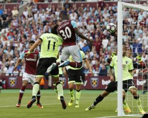 Michail Antonio heads the ball in for West Ham. Photo: Reuters