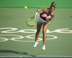 Monica Puig in action against Garbine Muguruza. Photo: Reuters