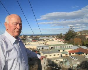 Dennis Norman overlooks the main zone substation in Chelmer St that supplies power to about three...