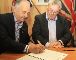 Waitaki District Council chief executive Michael Ross (left) and Waste Management NZ South Island...