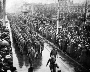Troops from the 16th Reinforcements parade through the Octagon, Dunedin, on August 19. - Otago...