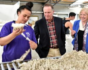 Phoebe Rangiuaia, of Mataura, shows Prime Minister John Key and Waitaki MP Jacqui Dean the art of...