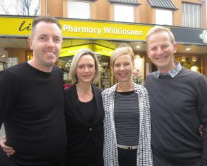 Glenn Mitchell (left) and Bronwen Judkins (second left) are buying Wilkinsons Pharmacy, in...