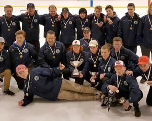 The victorious Junior Stampede side celebrates at the Dunedin Ice Stadium at the weekend. Back...
