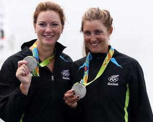 Silver medalists Genevieve Behrent (left) and Rebecca Scown of New Zealand celebrate after the...