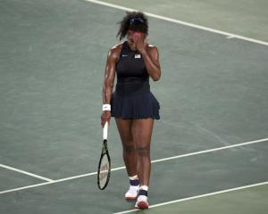 Serena Williams reacts after losing in the Olympics. Photo: Reuters