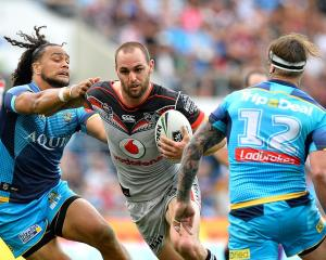 Simon Mannering tries to break a tackle. Photo: Getty Images