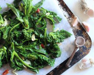 Sprouting broccoli with toasted garlic and chilli. Photo by Simon Lambert.