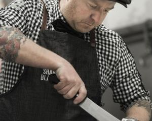 Dunedin butcher and Sharp Blacks competitor Greg Egerton preps a cut of meat.Photo: Supplied