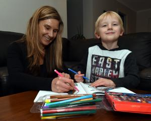 University of Otago researcher Dr Leah Watkins and her nephew Harper Buis (4) add some colours....