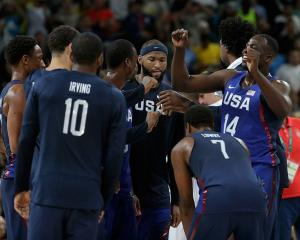 The USA basketball team celebrates after winning gold. Photo: Getty Images