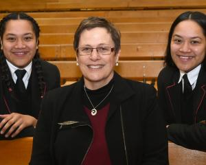 Twins Louine (left) and Teukisia Vaitohi (both 18) and Waitaki Girls High School principal Tracy...