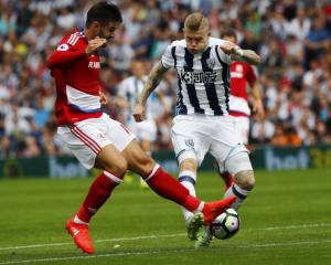 West Brom's James McLean has a shot at goal. Photo: Reuters