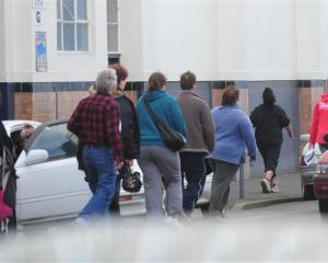 Workers leave the Cadbury factory in Dunedin after a meeting over future job cuts. Photo by Craig...