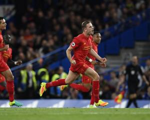 Liverpool players celebrate a goal against Chelsea. Photo: Reuters