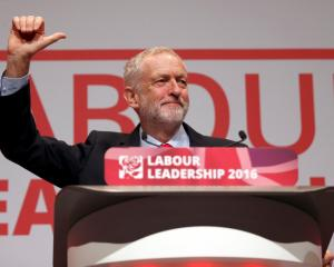 Jeremy Corbyn celebrates in Liverpool after the announcement of his victory in the Labour...