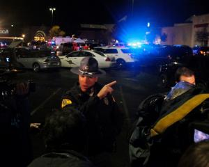 A Washington State Trooper speaks to the media at the Cascade Mall during the incident. Photo...
