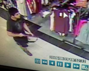 An image taken from security video shows a man who allegedly opened fire in the Cascade Mall in...