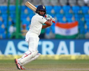Rohit Sharma made a half-century in India's second innings. Photo Reuters