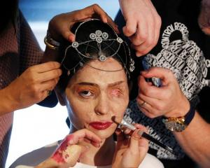 Reshma Quereshi has make-up applied before appearing during New York Fashion Week. Photos Reuters