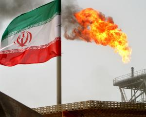 Gas flares on an Iranian oil platform in the Soroush oil fields; Iran has signalled  it is on...