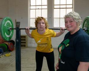 Special Olympics Otago powerlifting team member Kara Brash (left), the only female member of the...