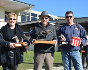 Lorraine, Brian (centre) and Shane Anderton with their swag of trophies won at the Otago Racing...