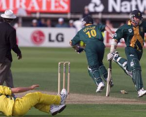 South African batsman Allan Donald (No 10) sprints for the crease in vain after he and team-mate...