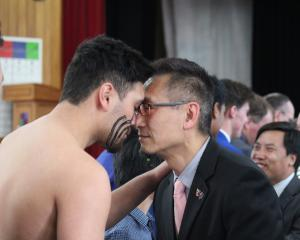 South Otago High School pupil Hemi Waenga (18, left) greets Confucius Institute director and...