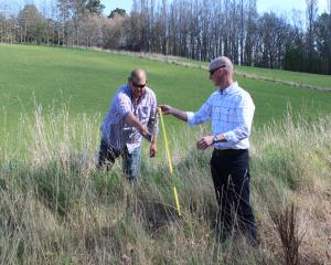 West Otago Community Board members Bruce Robertson (left) and John Herbert measure a possible...
