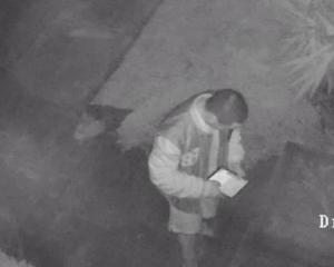 CCTV footage of a man with the iPad he took while stealing from a Pakuranga, Auckland home on...