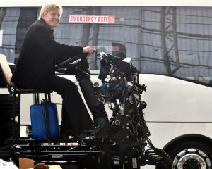 Amanda Cotter, of Auckland, sits on the chassis of a 2015 Mercedes-Benz XBC, one of many exhibits...