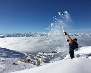 A snowboarder flicks up powder snow at the Cardrona Alpine Resort earlier this season. Photo:...