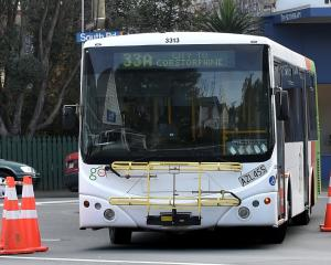 A Go Bus navigates the intersection of Playfair St and South Rd, where road cones were used to...