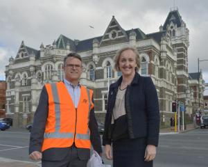 Amalgamated Builders managing director Richard Johnston and Justice Minister Amy Adams outside...