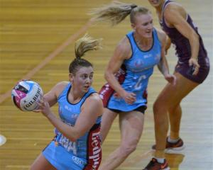 Crampton looks to move the ball on against the Firebirds, as Steel centre Shannon Francis and...