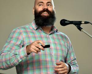 Dunedin City Council heritage policy planner Glen Hazelton speaks last night in  the St Paul's...
